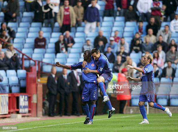 George Boateng celebrates in front of the empty seats after scoring Middlesbrough's second goal during the Barclays Premiership match between Aston...