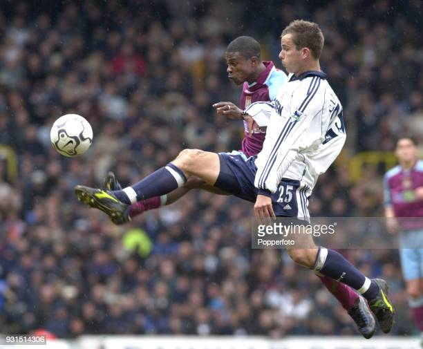 George Boateng of Aston Villa is challenged by Stephen Clemence of Tottenham Hotspur during the FA Carling Premiership match between Tottenham...