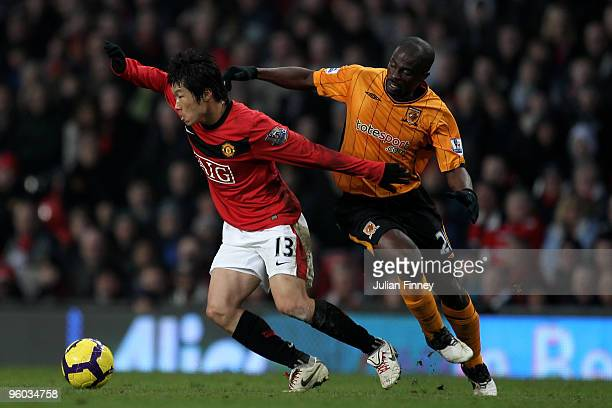 George Boateng of Hull battles with JiSung Park of Manchester United during the Barclays Premier League match between Manchester United and Hull City...