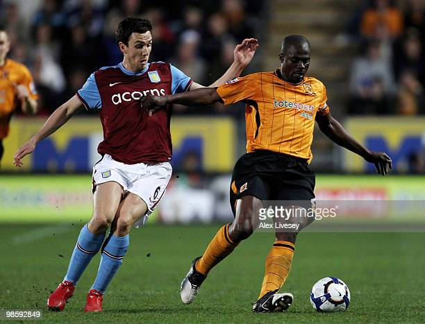 George Boateng of Hull City holds off a challenge from Stewart Downing of Aston Villa during the Barclays Premier League match between Hull City and...