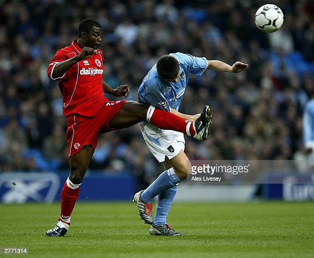 George Boateng of Middlesbrough hits the ball away from Joey Burton of Manchester City during the FA Barclaycard Premiership match between Manchester...