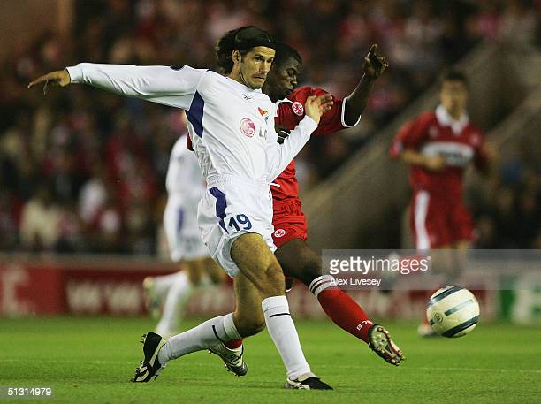 George Boateng of Middlesbrough tackles Marek Zubek of Banik Ostrava during the UEFA Cup first round, first leg match between Middlesbrough and Banik...