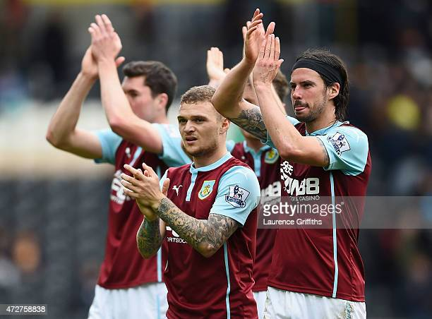 George Boyd and Kieran Trippier of Burnley applaud the fans after their team was relegated after the Barclays Premier League match between Hull City...