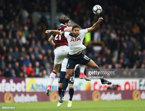 George Boyd of Burnley and Mousa Dembele of Tottenham Hotspur battle to win a header during the Premier League match between Burnley and Tottenham...