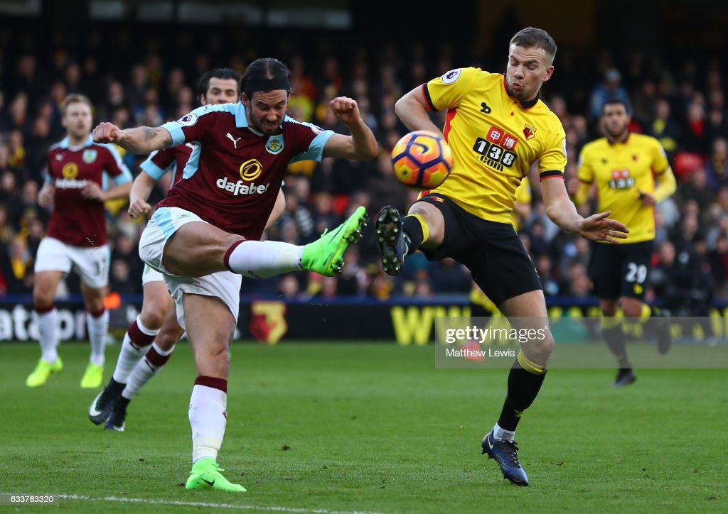 George Boyd of Burnley and Tom Cleverley of Watford compete for the ball during the Premier League match between Watford and Burnley at Vicarage Road on February 4, 2017 in Watford, England.