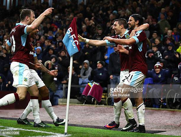 George Boyd of Burnley celebrates scoring his sides third goal with Stephen Ward of Burnley and Ashley Barnes of Burnley during the Premier League...