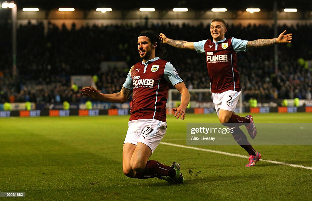 George Boyd of Burnley (L) celebrates scoring the opening goal with Kieran Trippier of Burnley during the Barclays Premier League match between Burnley and Manchester City at Turf Moor on March 14, 2015 in Burnley, England.