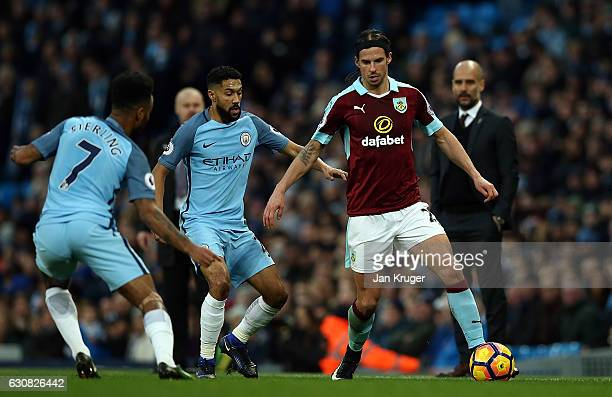 George Boyd of Burnley controls the ball from Raheem Sterling of Manchester City during the Premier League match between Manchester City and Burnley...