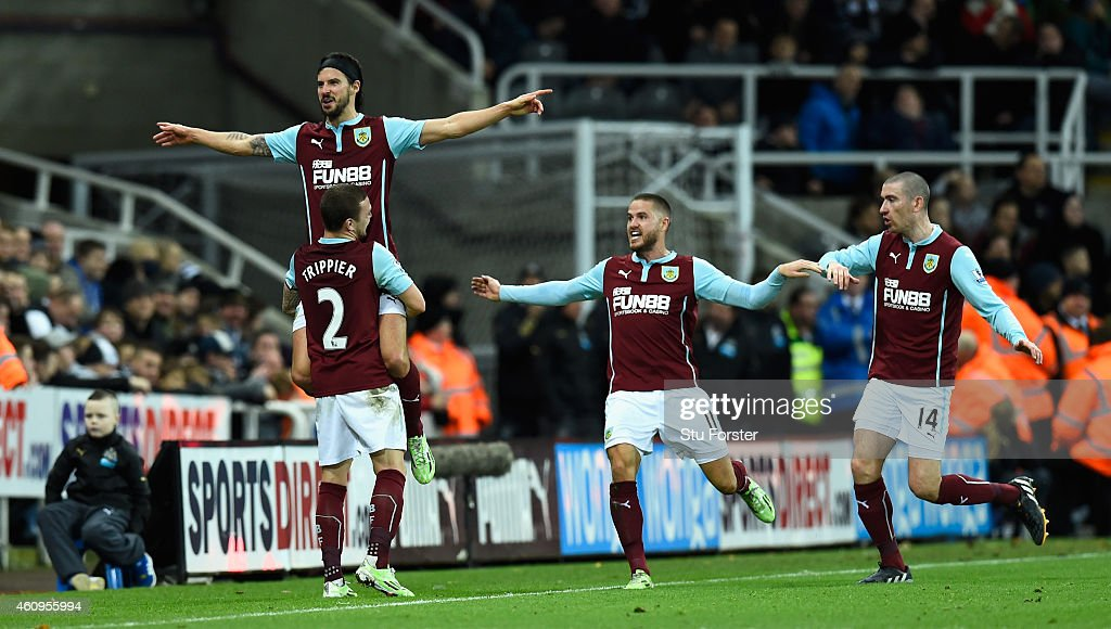 George Boyd of Burnley is lifted up after scoring the third Burnley goal during the Barclays Premier League match between Newcastle United and Burnley at St James' Park on January 1, 2015 in Newcastle upon Tyne, England.