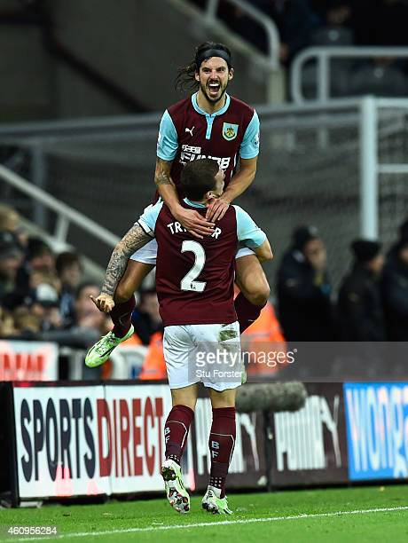 George Boyd of Burnley is lifted up by Kieran Trippier after scoring the third Burnley goal during the Barclays Premier League match between...