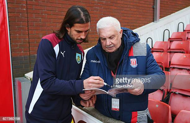 George Boyd of Burnley signs autographs prior to the Premier League match between Stoke City and Burnley at Bet365 Stadium on December 3 2016 in...