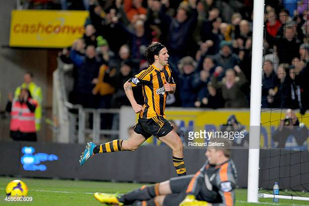 George Boyd of Hull City celebrates as Robbie Stockdale of Fulham lies beaten after Hull's 3rd Goal during the Barclays Premier League match between...
