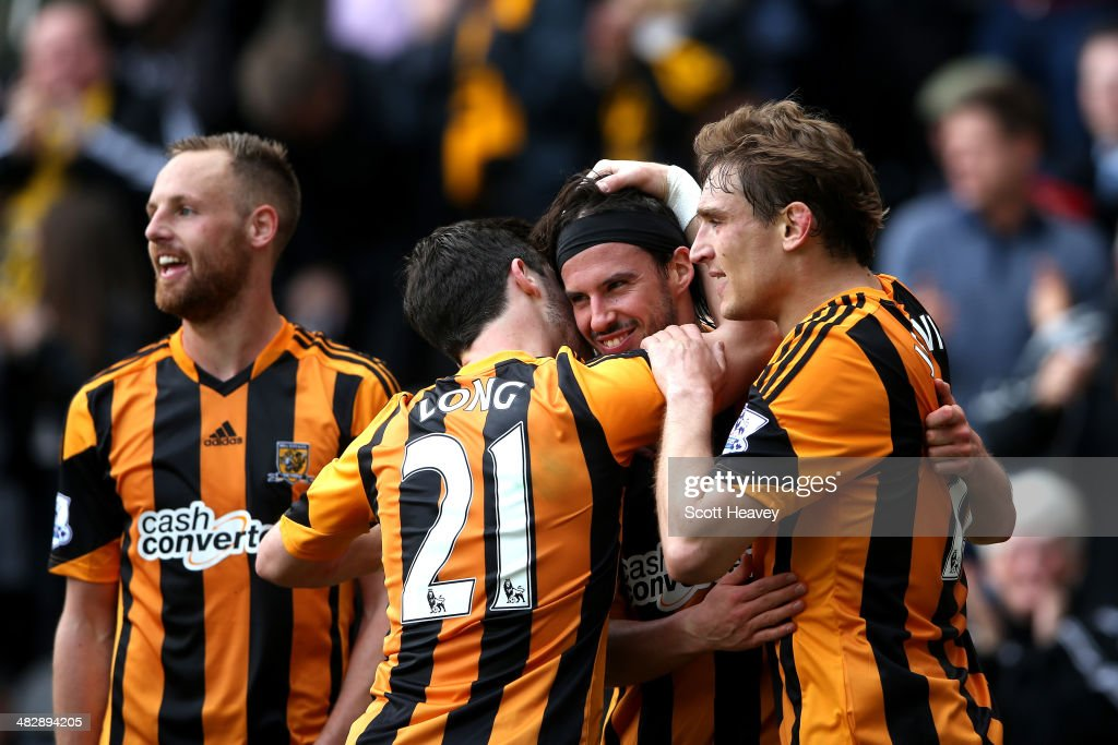 George Boyd (2nd R) of Hull City celebrates with teammates after scoring the opening goal with a header during the Barclays Premier league match between Hull City and Swansea City at KC Stadium on April 5, 2014 in Hull, England.