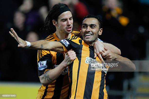 George Boyd of Hull City congratulates teammate Ahmed Elmohamady after scoring a goal during the Barclays Premier League match between Hull City and...