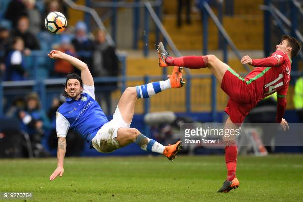 George Boyd of Sheffield Wednesday competes for the ball with Tom Carroll of Swansea City during the The Emirates FA Cup Fifth Round between...