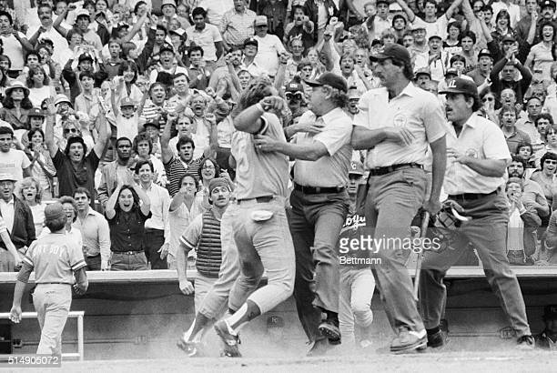 George Brett argues with the umpires who ruled out his tworun homer after an examination of his bat showed that the pine tar had exceeded the...