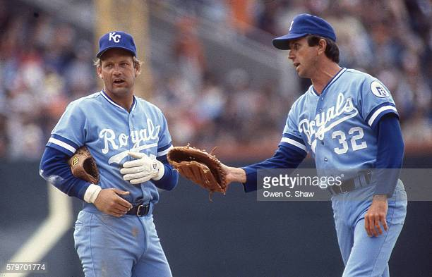 George Brett of the Kansas City Royals circa 1983 confers with pitcher Larry Gura in a game against the Baltimore Orioles at Memorial Stadium in...
