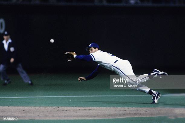 George Brett of the Kansas City Royals fields a ball during Game 7 of the1985 World Series against the St Louis Cardinals at Royals Stadium on...