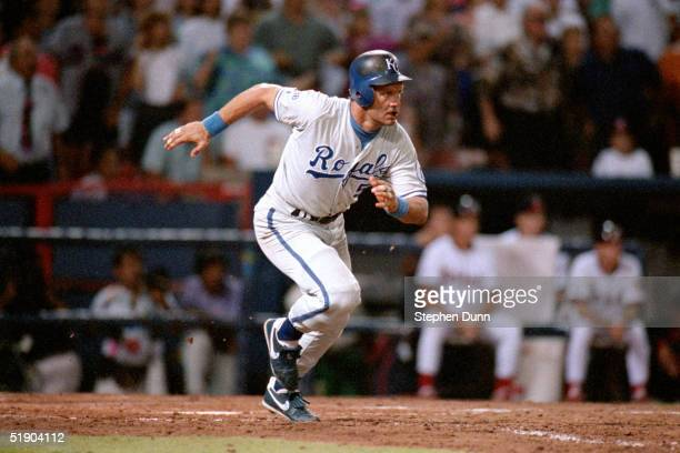 George Brett of the Kansas City Royals runs out of the batters box onto first base as he gets his 3000 career hit against the California Angels on...