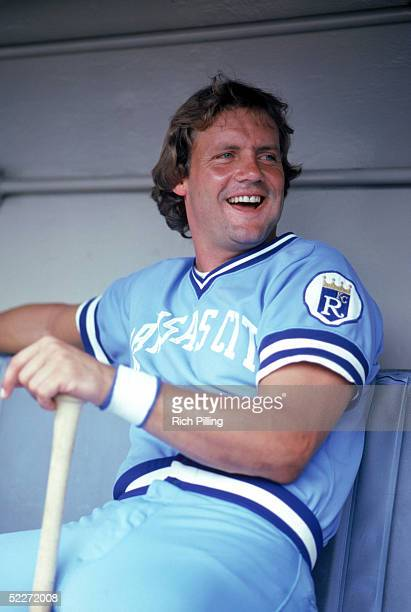 George Brett of the Kansas City Royals smiles as he sits in the dugout during the 1980 MLB season