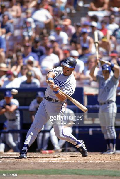 George Brett of the Kansas City Royals swings at a pitch during a game against the California Angels at Angels stadium on August 5 1993 in Anaheim...