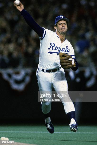 George Brett of the Kansas City Royals throws to first base during Game 1 of the 1985 World Series against the St Louis Cardinals at Royals Stadium...