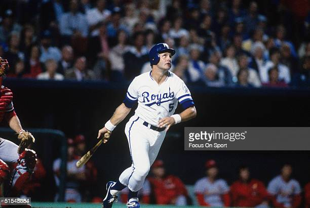 George Brett of the Kansas City Royals watches his ball fly and starts to run to first against the St Louis Cardinals during the World Series at...