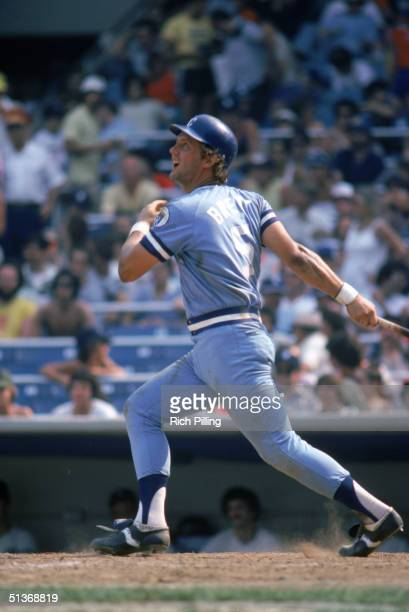 George Brett of the Kansas City Royals watches the flight as he follows through on a swing during a 1980 MLB season game