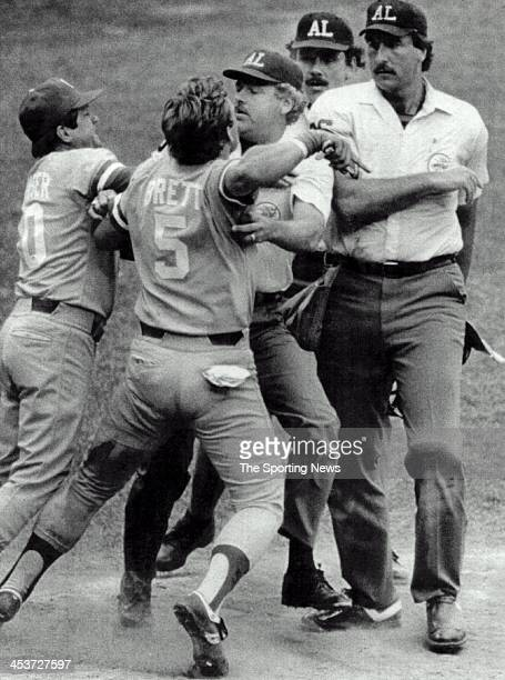 George Brett of the Royals restrained by umpire Joe Brinkman and Royals' manager Dick Houser as he tries to get to home plate umpire Tim McClelland...
