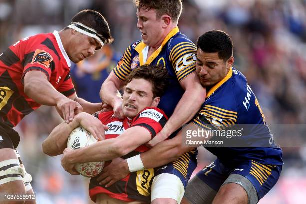 Josh Ioane of Otago breaks the tackle of Chris King and Daniel LienertBrown of Canterbury during the round six Mitre 10 Cup match between Otago and...