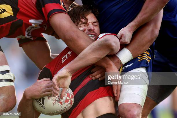 George Bridge of Canterbury is tackled during the round six Mitre 10 Cup match between Otago and Canterbury at Forsyth Barr Stadium on September 22...