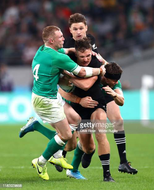 George Bridge of New Zealand is tackled by Keith Earls and Garry Ringrose of Ireland during the Rugby World Cup 2019 Quarter Final match between New...