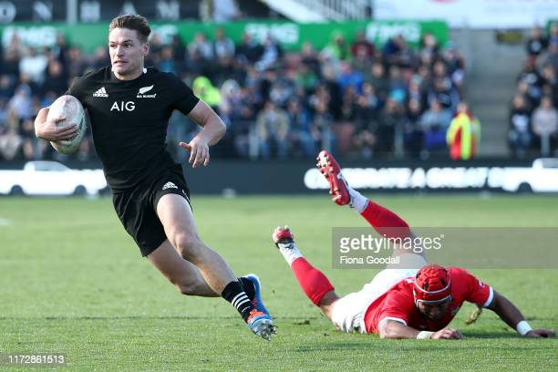 George Bridge of the All Blacks scores a try during the rugby Test Match between the New Zealand All Blacks and Tonga at FMG Stadium on September 07,...