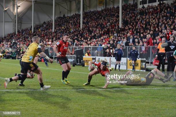 George Bridge of the Crusaders dives over to score a try during the Super Rugby Semi Final match between the Crusaders and the Hurricanes at AMI...