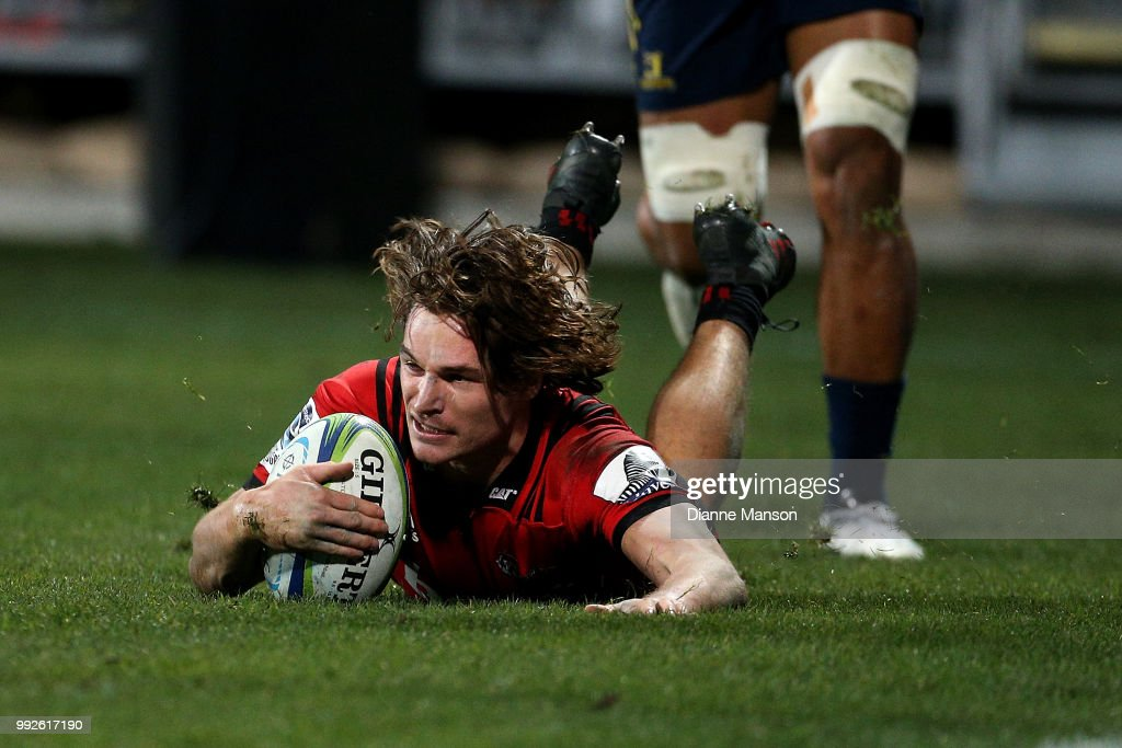 George Bridge of the Crusaders dives over to score a try during the round 18 Super Rugby match between the Crusaders and the Highlanders at AMI Stadium on July 6, 2018 in Christchurch, New Zealand.