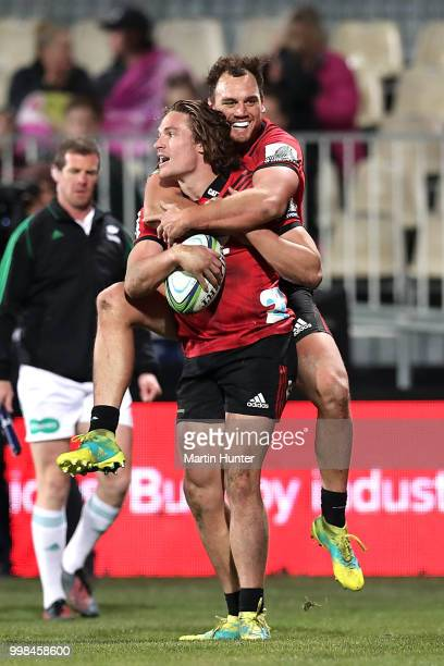 George Bridge of the Crusaders is congratulated by team mate Israel Dagg after scoring a try during the round 19 Super Rugby match between the...