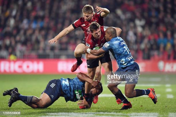 George Bridge of the Crusaders is tackled by Mark Telea of the Blues during the round 5 Super Rugby Aotearoa match between the Crusaders and the...