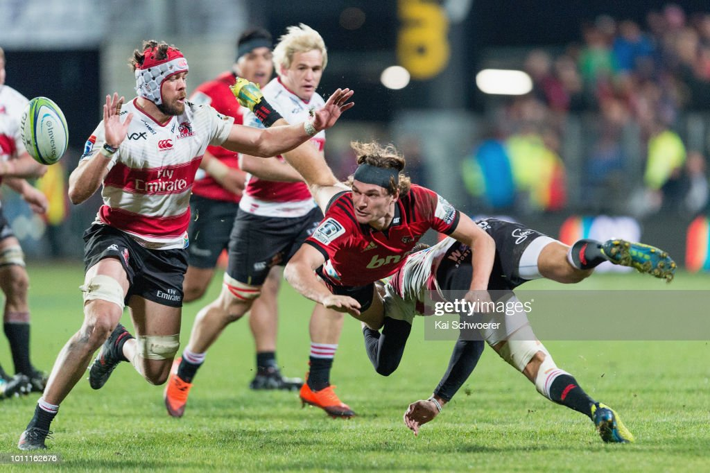 George Bridge of the Crusaders offloads the ball during the Super Rugby Final match between the Crusaders and the Lions at AMI Stadium on August 4, 2018 in Christchurch, New Zealand.
