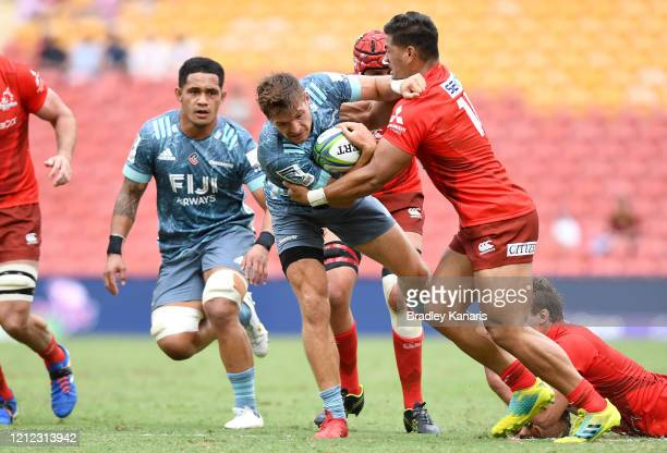 George Bridge of the Crusaders takes on the defence during the round seven Super Rugby match between the Sunwolves and the Crusaders at Suncorp...