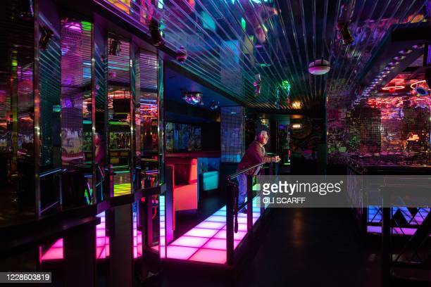 George Brooks, a nightclub lighting technician, poses for a photograph in the PRYZM nightclub in Leeds, central England on September 18 as it remains...