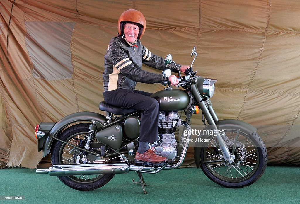 George Brown, aged 91, helps to celebrate the unveiling of the new Royal Enfield accessory range inspired by World War II dispatch riders at the Goodwood Revival on September 12, 2014 in Goodwood, England. George was a dispatch rider during the Second World War.