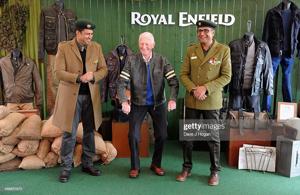 George Brown, aged 91, with Abhijit Singh Brar, Head of Marketing for Royal Enfield (L) and Arun Gopal , Head of Entertainment Business for Royal Enfield, helps to celebrate the unveiling of the new Royal Enfield accessory range inspired by World War 2 dispatch riders at the Goodwood Revival on September 12, 2014 in Goodwood, England. George was a dispatch rider during the Second World War.