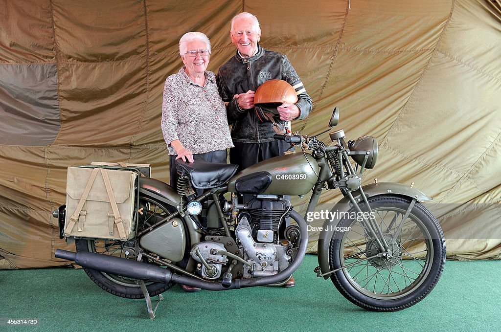 George Brown, aged 91, with his wife Thelma, helps to celebrate the unveiling of the new Royal Enfield accessory range inspired by World War 2 dispatch riders at the Goodwood Revival on September 12, 2014 in Goodwood, England. George was a dispatch rider during the Second World War.