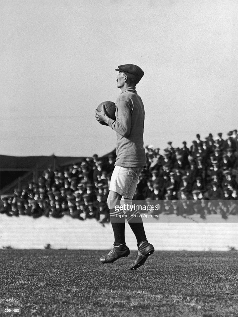 George Burdett, the Woolwich Arsenal goalkeeper, holding the ball during a game against Liverpool. Previously known as Dial Square and then Royal Arsenal, Woolwich Arsenal changed their name to Arsenal in 1914.