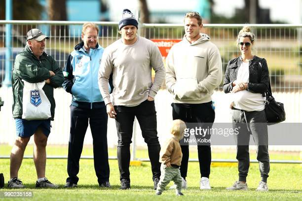 George Burgess and Tom Burgess watch on during a New South Wales Blues State of Origin media session at Coogee Oval on July 3 2018 in Sydney Australia