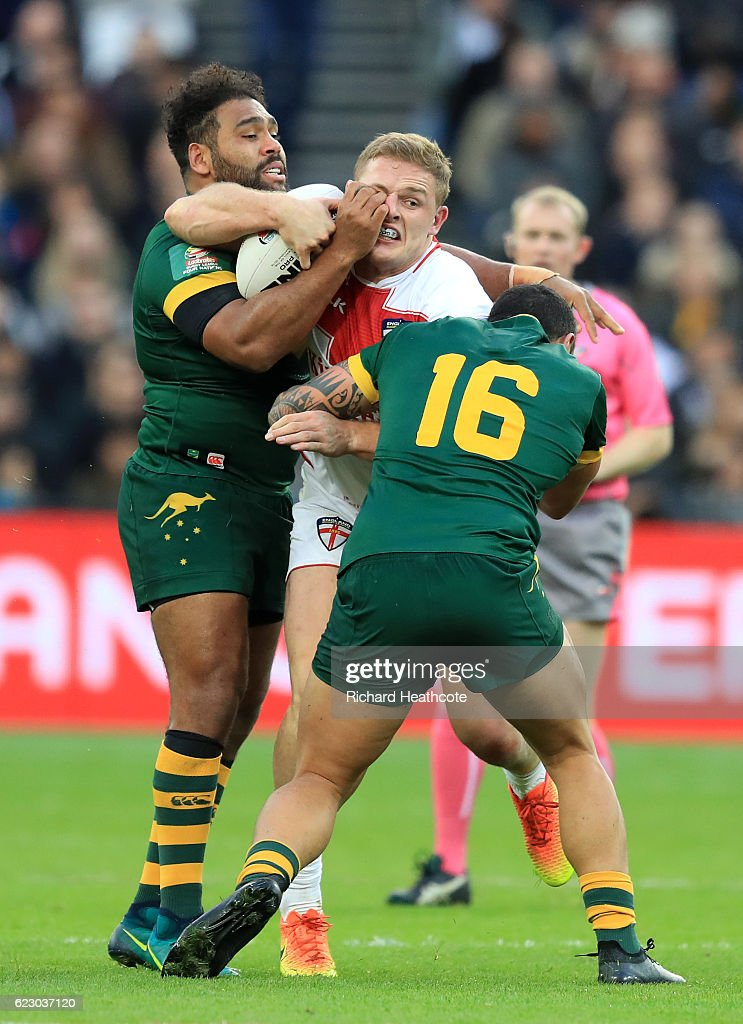 George Burgess of England is tackled by Tyson Frizell and Sam Thaiday of Australia during the Four Nations match between the England and Australian Kangaroos at Olympic Stadium on November 13, 2016 in London, United Kingdom.