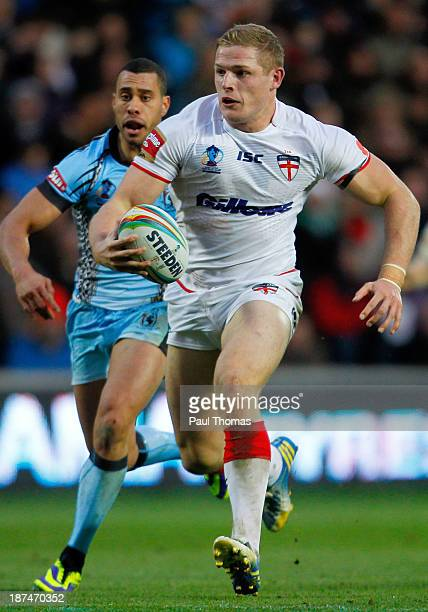 George Burgess of England makes a break during the Rugby League World Cup Group A match at the KC Stadium on November 9 2013 in Hull England