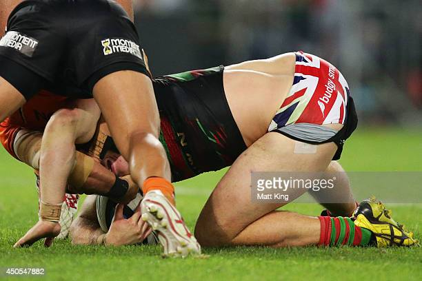 George Burgess of the Rabbitohs is tackled and is shown wearing underwear printed with the union jack during the round 14 NRL match between the South...