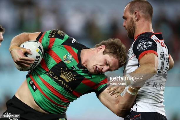 George Burgess of the Rabbitohs is tackled by Simon Mannering of the Warriors during the round 24 NRL match between the South Sydney Rabbitohs and...