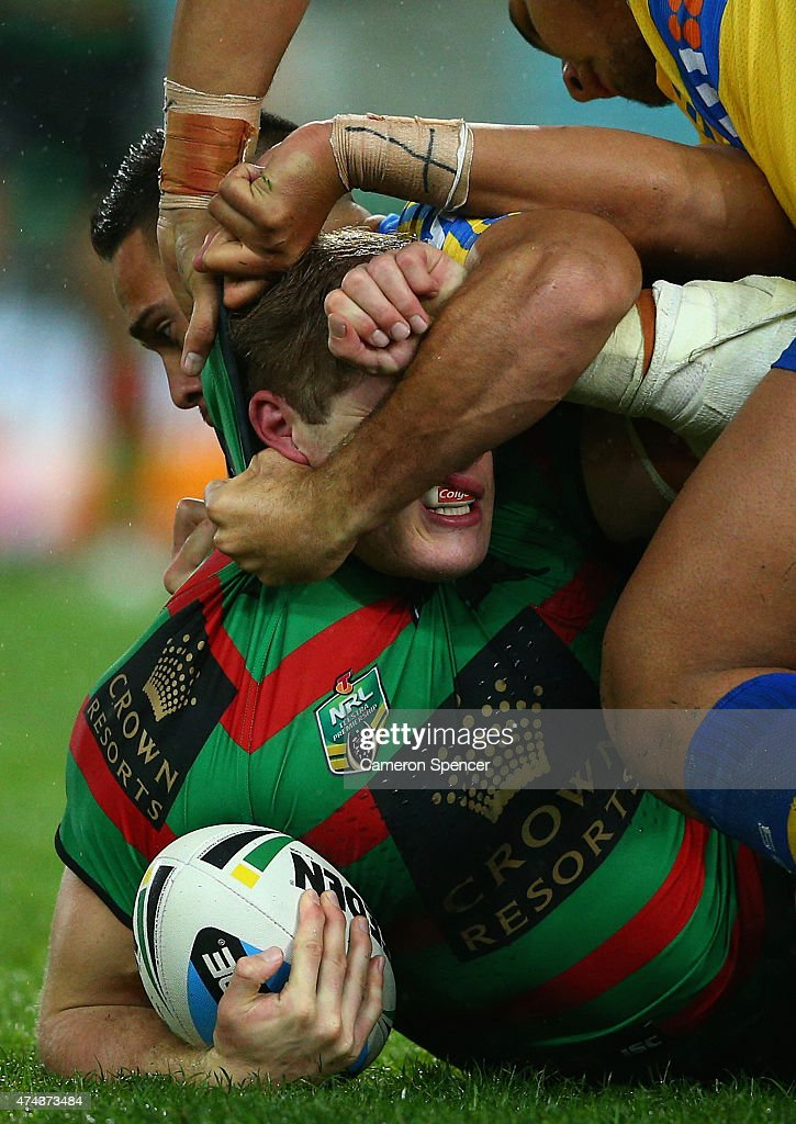 George Burgess of the Rabbitohs is tackled during the round 11 NRL match between the South Sydney Rabbitohs and the Parramatta Eels at ANZ Stadium on May 22, 2015 in Sydney, Australia.